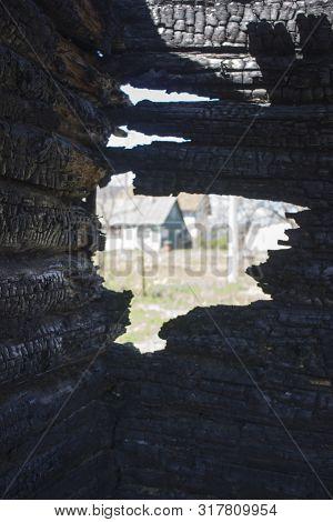 Black Background. Burnt Wooden Board Texture. Burned Scratched Hardwood Surface. Smoking Wood Plank