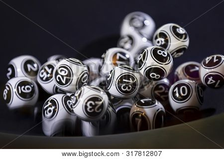 Black And White Lottery Balls In A Bingo Machine. Lottery Balls In A Sphere In Motion. Gambling Mach