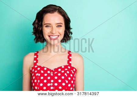 Close up portrait of fascinating young beautiful wonderful lady posing in front of came while isolated with teal background poster