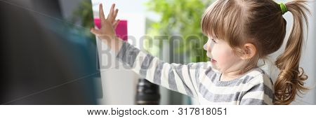 Cute Little Girl Sitting At Home At Worktable Working With Computer Portrait