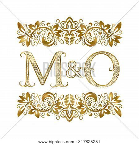 M And O Vintage Initials Logo Symbol. The Letters Are Surrounded By Ornamental Elements. Wedding Or