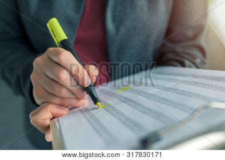 Businesswoman Highlight Business Report Results Paper, Close Up Of Hand With Highlighter, Selective