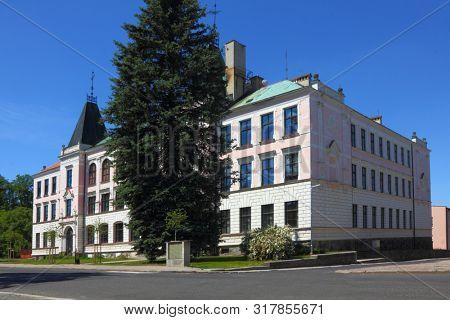 Facade of old building in Sluknov, Czech Republic