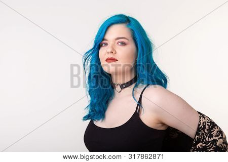 People and fashion concept - Young woman with choker and blue hair posing over white background poster