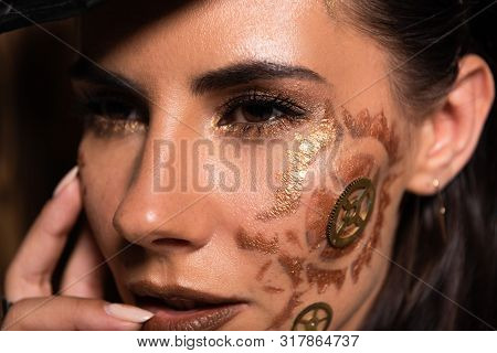 Pensive Attractive Young Woman With Steampunk Makeup Looking Away
