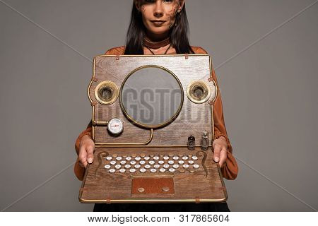 Cropped View Of Woman Showing Steampunk Laptop Isolated On Grey