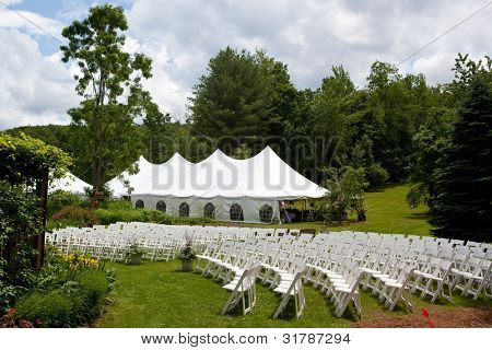 Wedding tent set up for an outdoor wedding or other event. chairs set up for an outdoor ceremony