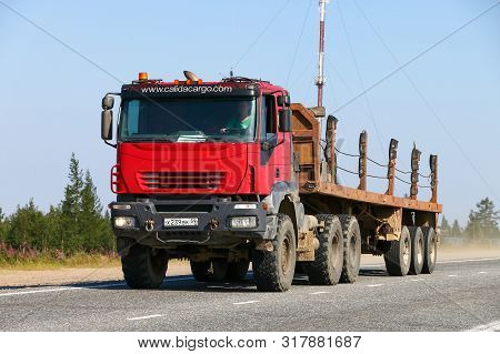 Novyy Urengoy, Russia - August 3, 2019: Offroad Semitrailer Truck Iveco Trakker At The Interurban Ro