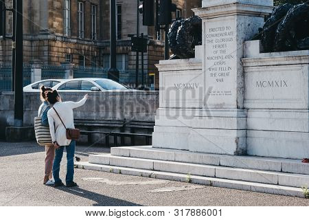 London, Uk - July 15, 2019: People Looking At Machine Gun Corps Memorial In London, Uk, Also Known A