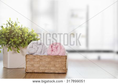 Clean Cotton Towels On Wooden Counter Table On Blurred Bright Bathroom Background. Copy Space For Pr