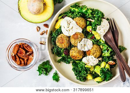 Vegan Lentils Meatballs With Green Kale Salad, Avocado And Tahini Dressing In A White Dish. Healthy