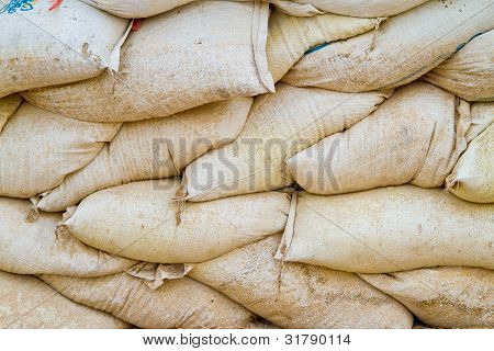 stack of old sand bags
