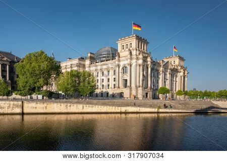 Berlin, Germany - May 18, 2019: Reichstag building german government and river Spree in Berlin, Germany