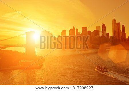 Beautiful Sunset Over A Manhattan And Brooklyn Bridge.