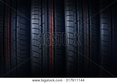 New Tires Background. Photo Was Taken Close To The Tire Texture. Beautiful Tyres Pattern For Your De