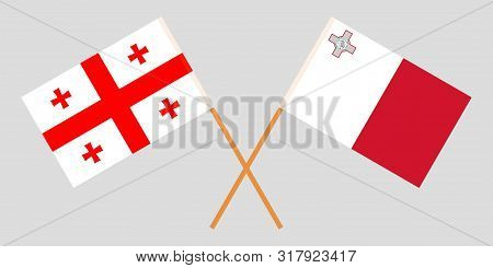 Georgia And Malta. Crossed Georgian And Maltese Flags. Official Colors. Correct Proportion. Vector I