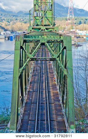 A railway bridge over inlet in North Vancouver, Canada.