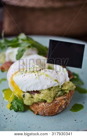 Close-up Poached Egg With Yolk On Toast With Avocado And Salad, Poached Egg Close-up View