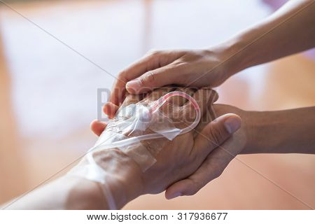 Closeup Of Couple Holding Hands In Hospital