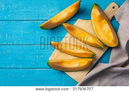 Sliced Ripe Melon On Wooden Table, Top View