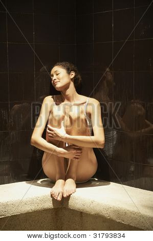 Woman sitting in spa room