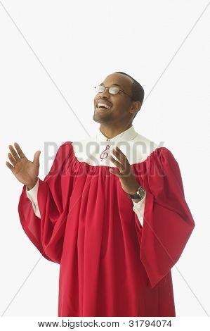 Man in choir robe singing