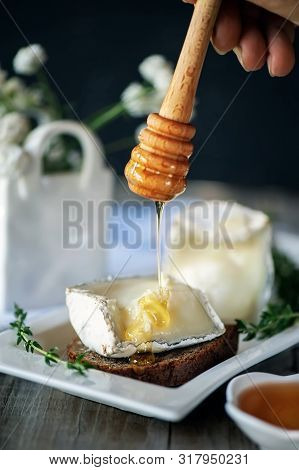 Traditional French Goat Milk Cheese Saint-maure-de-touraine On A Piece Of Delicate Farm Bread With H