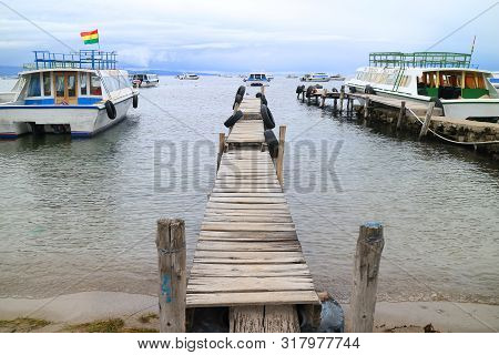 Copacabana Town, Bolivia - April 28, 2018 : Wooden Docks Surrounded By The Boats To Isla Del Sol On