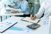 businessman in meeting analysis chart graphy marketing plan in business financial  audit project. Or Business adviser analyzing Budget. poster