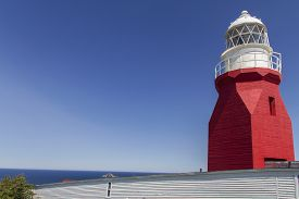 Red Concrete Long Point Lighthouse At Twillingate, Newfoundland; Blue Sky