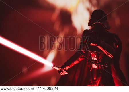 APRIL 14 2021: Star Wars Sith Lord Darth Vader with lightsaber battling Rebels - Hasbro action figure