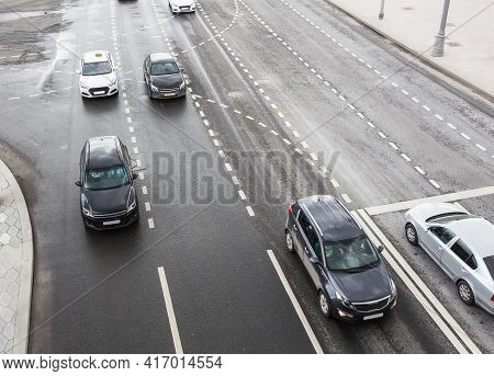 Cars Move Along A Multi-lane Highway. View From Above
