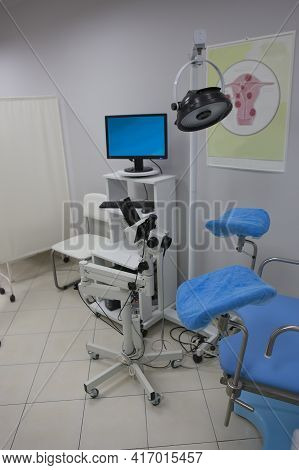 Gynecological Room Interior With Medical Equipment And Gynecological Chair