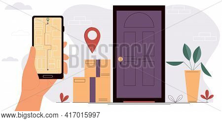 The Concept Of Fast, Free Home Delivery. Hand Holding A Smartphone With An Open Map. Online Delivery