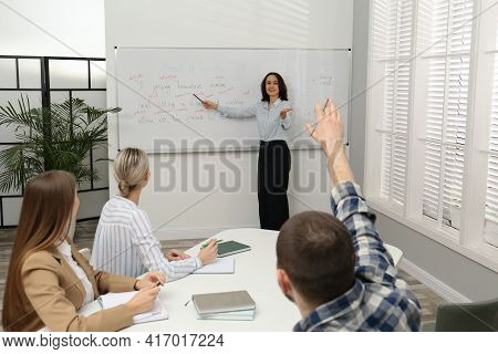 English Teacher Giving Lesson Near Whiteboard In Classroom