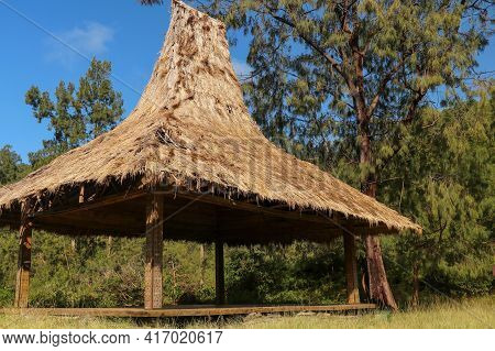Shelter With A Reed Roof By The Colorful Lakes On The Volcano Kelimutu. Traditional Architecture Of
