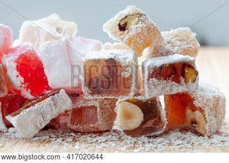 Turkish Delight Macro View. The Famous Oriental Dessert Marmalade With Nut Fillings And Powdered Sug