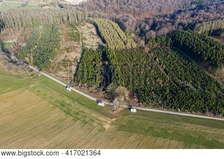 Aerial view on a campsite of camping-car group, in a field, belgian ardennes