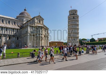 Pisa, Italy - June 25, 2019: Crowd Of Tourists Visit Leaning Tower Of Pisa In Summer Time
