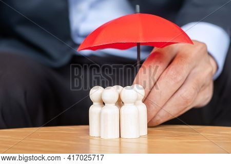 Businessman Hand Holding Umbrella And Cover Man Wooden From Crowd Of Employees. People, Business, Hu