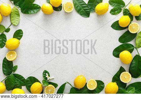 Lemons. Fresh Juicy Lemons With Leaves On White Background