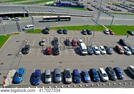 ST PETERSBURG, RUSSIA - MAY 11, 2016. Birds eye view of airport auto crowded parking lot in Pulkovo International airport in St Petersburg, Russia.Closeup of parking lot,parking lot view,parking lot place