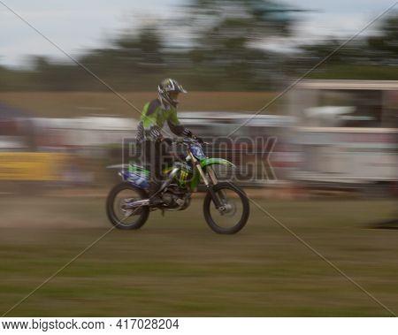 Deliberate Motion Blur Shot Of Scramble Motorbike At Speed