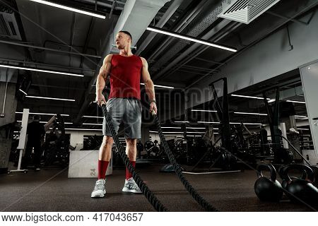 Sport. Strong Man Exercising With Battle Ropes At The Gym With. Athlete Doing Battle Rope Workout At