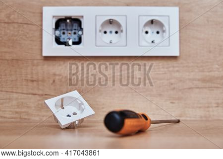 Broken Socket And Screwdriver On The Table. Installing Electrical Socket I Thekitchen