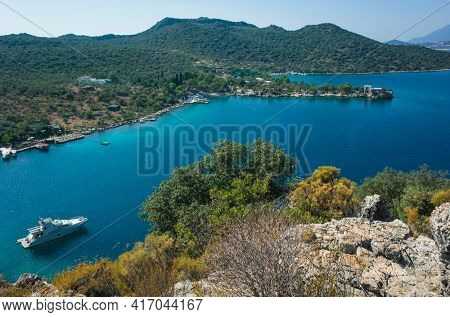 White boat anchored in picturesque bay near Kas, Mediterranean sea coast, Nature of Turkey, View from Lycian way hiking trail