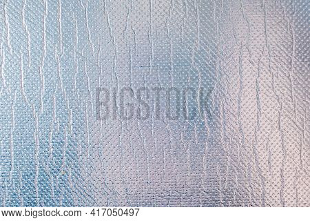 Large Sheet Of Shiny Silver Or Tin Foil. Gray Shiny Background