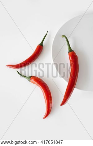 Red Chillies On White Plate. Hot Indian Asian Chillies