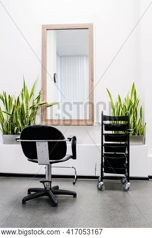 Hairdresser's Workplace. The Interior Of The Salon With A Hairdressing Chair Is Ready To Receive Vis