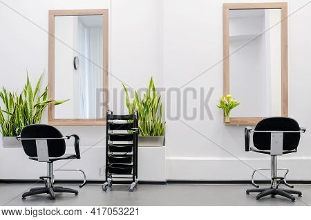 Workplace For Two Hairdressers The Interior Of The Hairdressing Salon With A Professional Chairs And